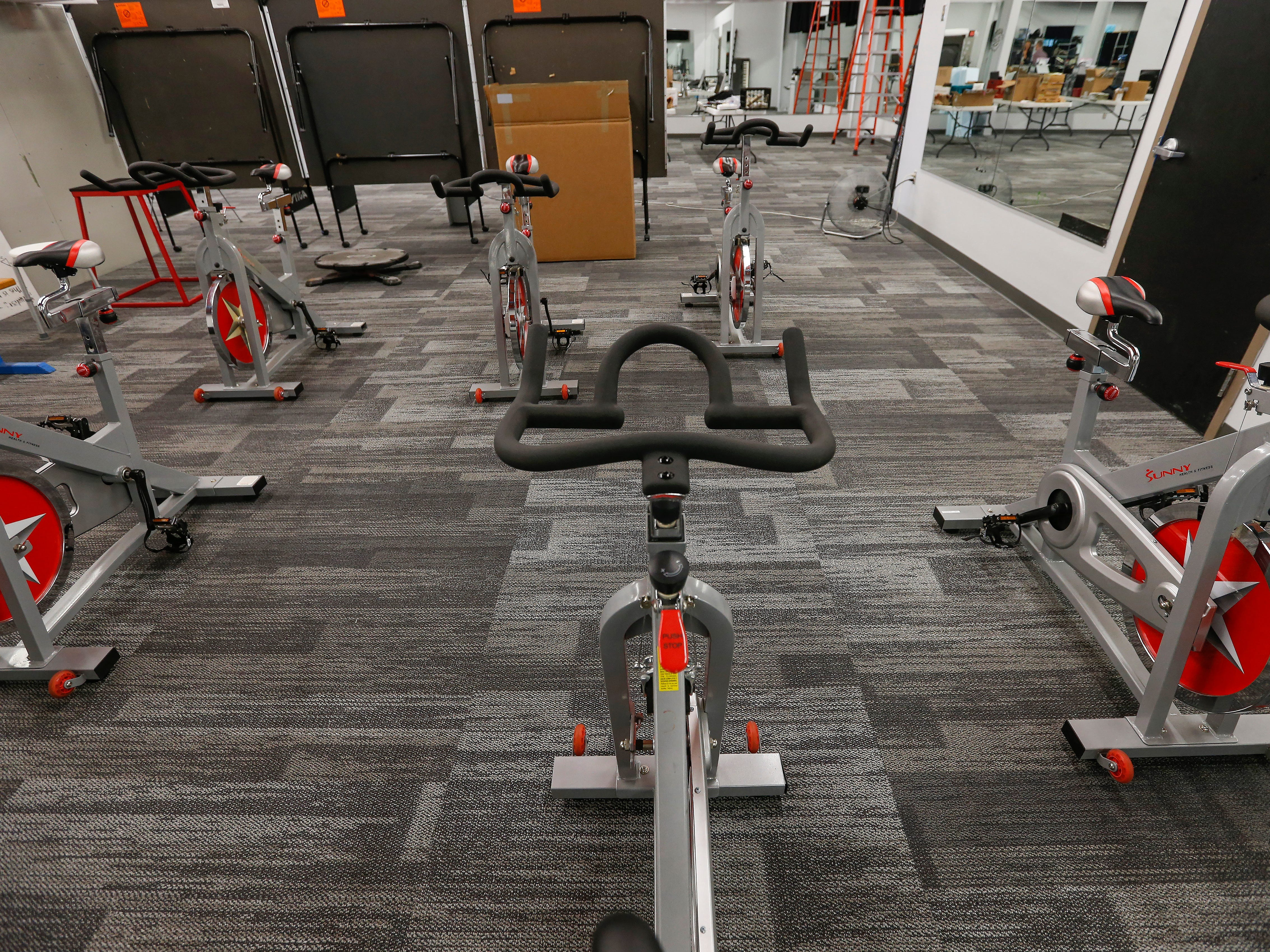 Stationary bikes inside a corner dedicated to physical education at the Summit Preparatory School.