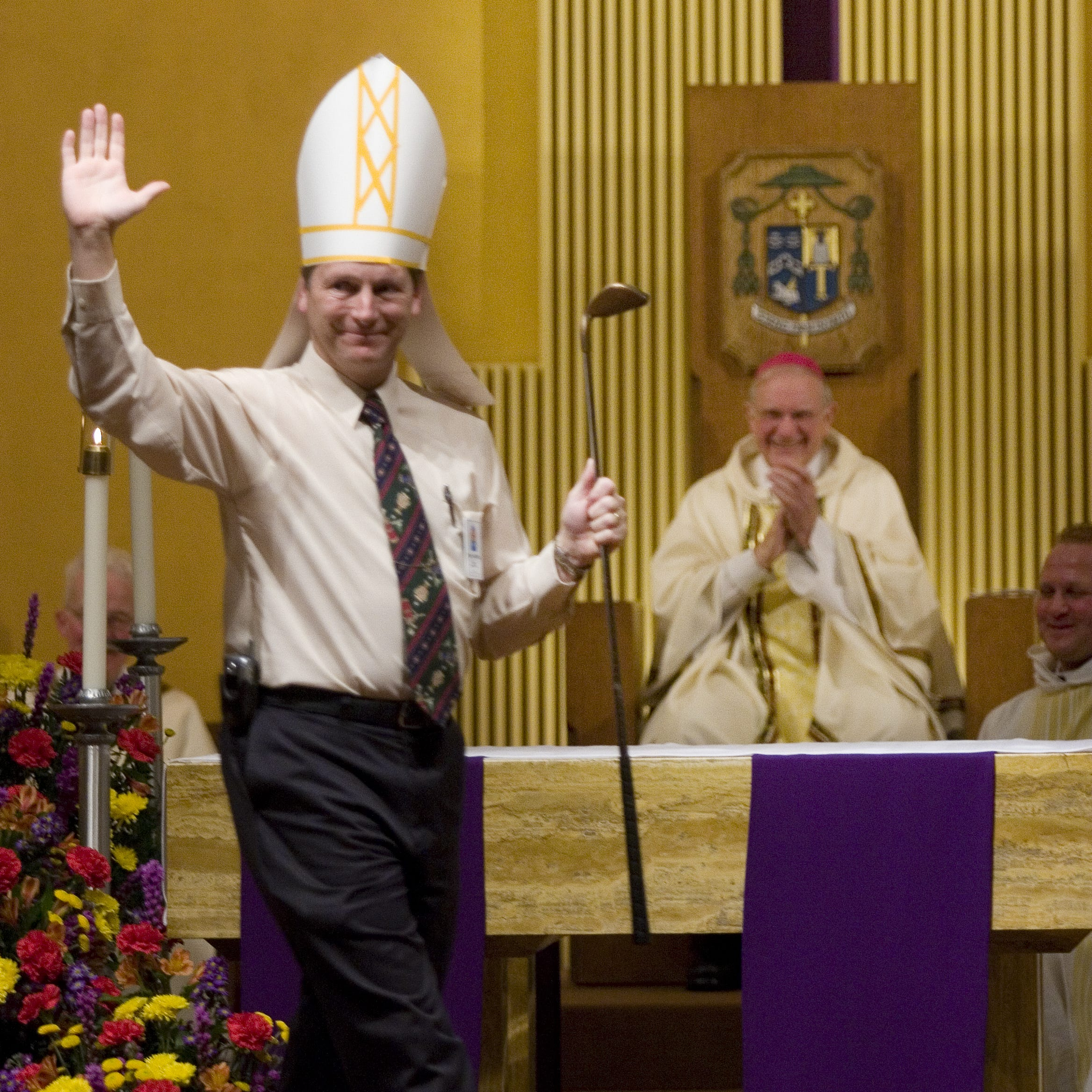 A 2008 photo of Troy Casteel, then-Director of Family Misistries for the Diocese, pointing out Bishop John Leibrecht's love of golf during a skit after Mass.