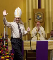 A 2008 photo of Troy Casteel, then-Director of Family Ministries for the Diocese, pointing out Bishop John Leibrecht's love of golf during a skit after Mass.