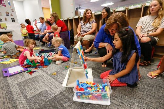 Pre-kindergarten teacher Linda Michaliszyn works with Kaya Shah, 4, at the Summit Preparatory School.