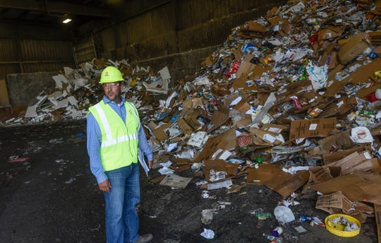 General Manager Jon Snyder stands in front of piles of recyclable material Wednesday, Aug. 15, at the Republic Services Transfer Center in East St. Cloud.