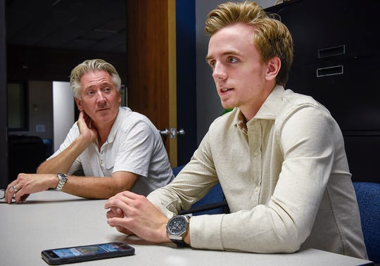 Wayne Jandik sits Thursday, Aug. 16, with his son Robbie as he describes developing his software app for gamers who play Fortnite.