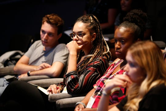 Television Academy Foundation intern Sierra Obioha (center) listens to an HBO executive on the making of Game of Thrones during a trip to HBO offices on July 12, 2018 in Santa Monica, Calif.