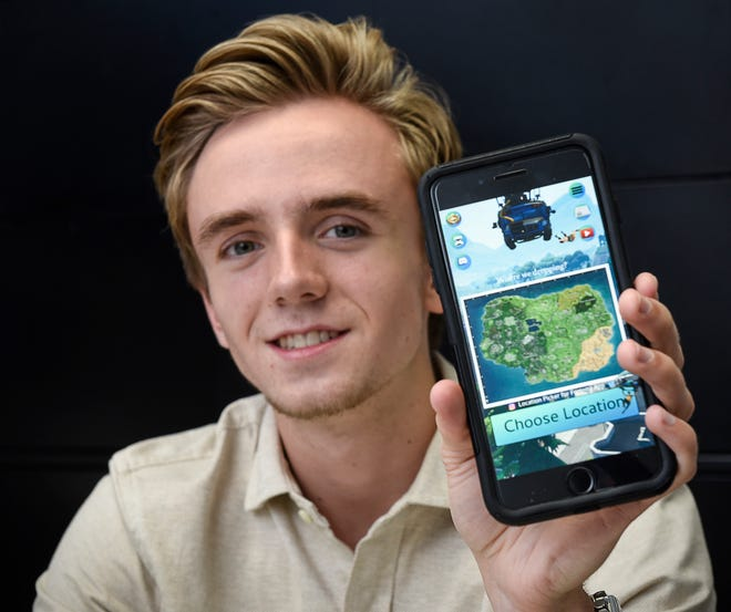 Robbie Jandik, 18, shows the software app he developed Thursday, Aug. 16, for gamers who play Fortnite.