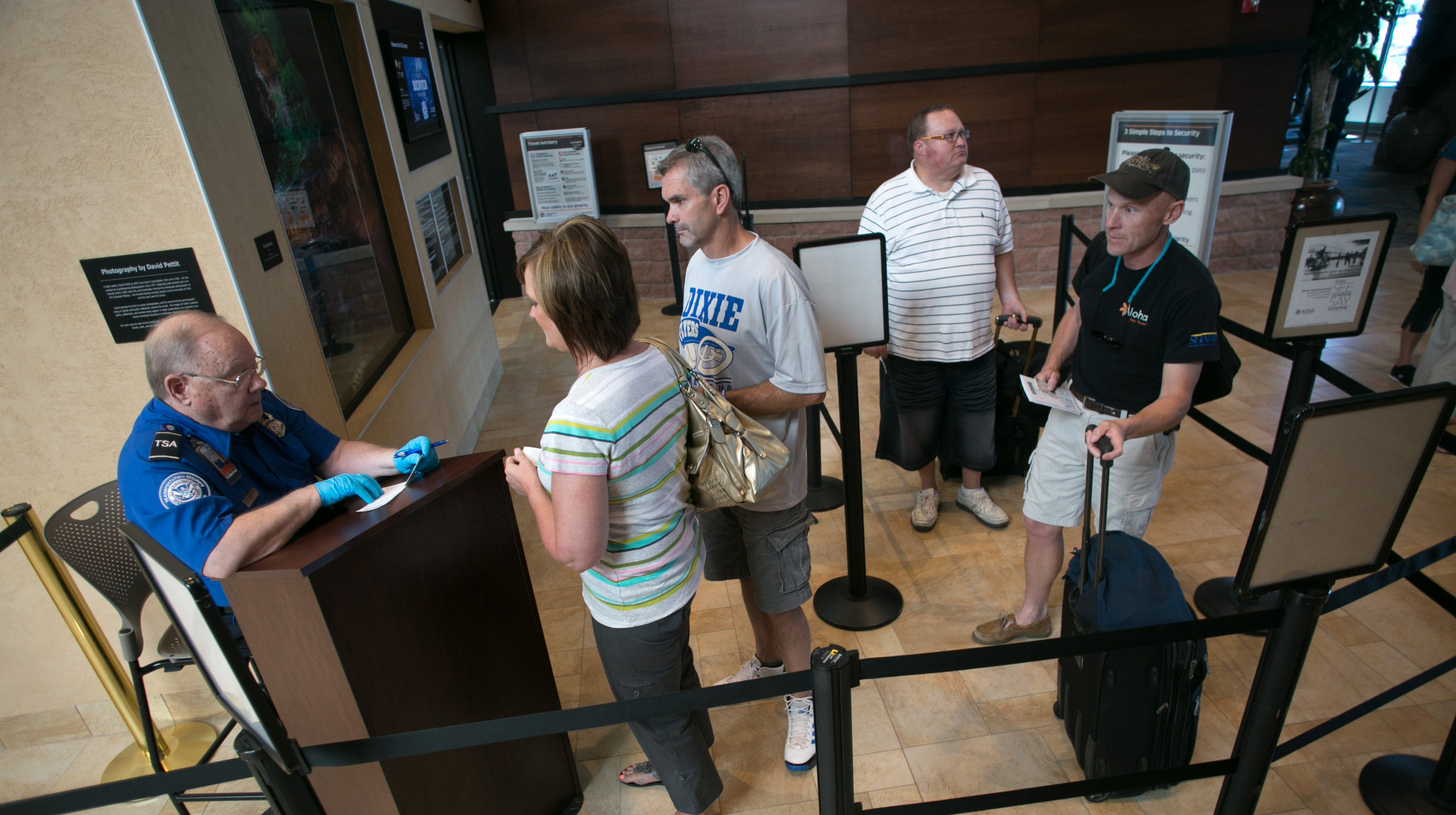 Passengers bound for Denver on the first SkyWest flight to Denver out of St. George make their way through security at the St. George Municipal Airport Thursday, June 6, 2013.
