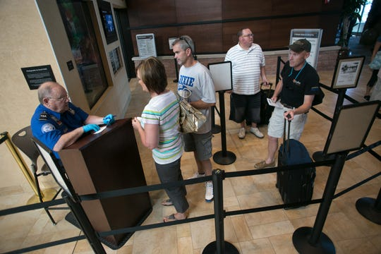 Passengers bound for Denver on the first SkyWest flight to Denver out of St. George make their way through security at the St. George Regional Airport in this Spectrum file photo. The airport is set to close this week for extensive repairs to the runway.