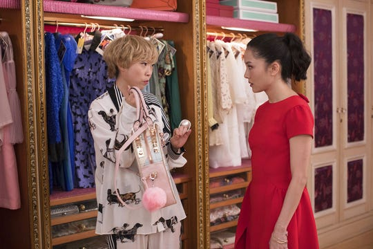 """Constance Wu, right, plays a character who turns to her friend, played by rapper Awkwafina. for fashion advice in the comedy """"Crazy Rich Asians."""""""