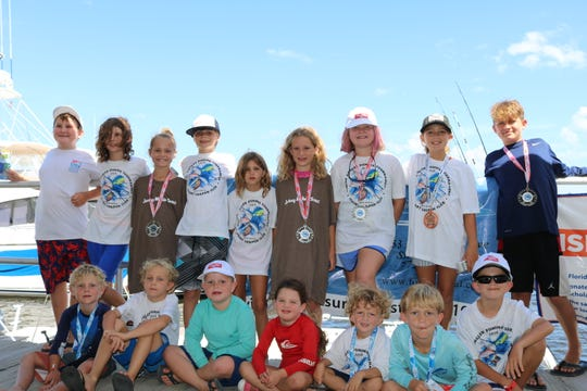 Some of the 90 kids who fished Saturday's Junior Angler Tournament by the Stuart Sailfish Club gathered for the awards.