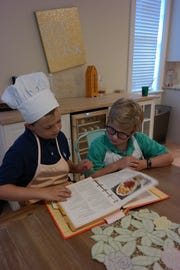 Both boys help with meal planning at home, looking through their moms' cookbooks for things that look interesting.