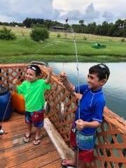 Marcus and Nathan practice for the Boys & Girls Clubs of St. Lucie County's Fishing for Futures tournament, Saturday, Sept. 1 at Causeway Cove Marina, Fort Pierce.