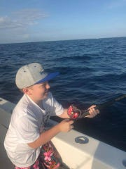 Zane Price, 10, puts the heat onto a 22-pound amberjack off Stuart Saturday during the Junior Angler Tournament.