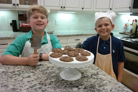 Jackson Harbin and Memphis Rains make the perfect after school snack – freshly baked chocolate cookies.