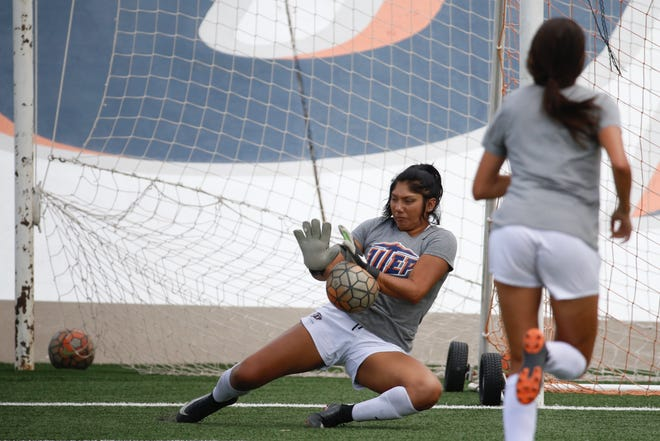 UTEP goalkeeper Alyssa Palacios doesn't let back pain keep her from her total commitment to helping the team.