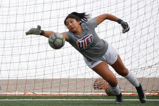 UTEP goalkeeper Alyssa Palacios leaps to block a ball during a recent practice. She hopes to continue playing soccer after college.