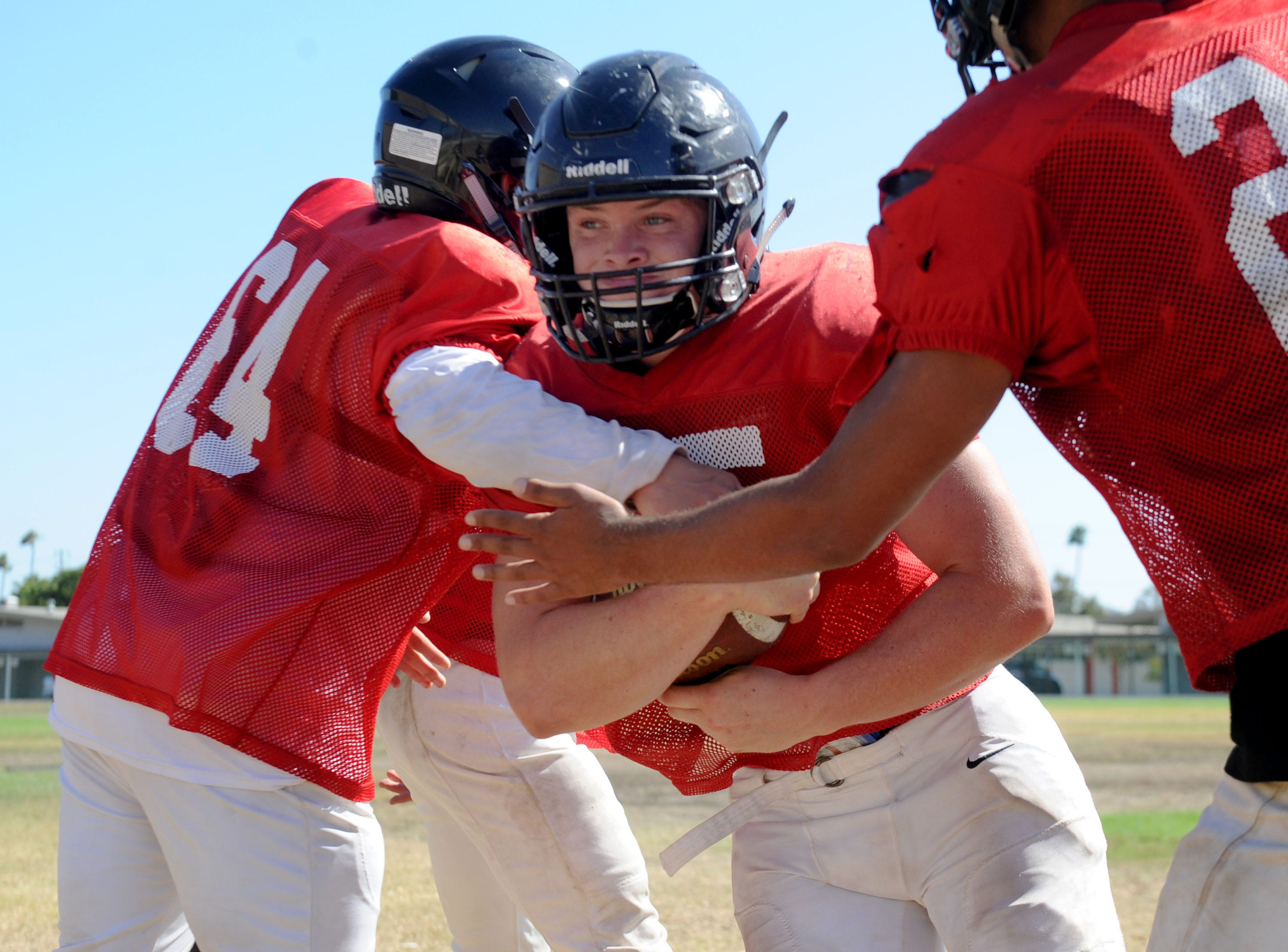 Running back Blake Kytlica tries to break through his teammates during Rio Mesa's practice. The Spartans play at Camarillo on Friday night in a season opener