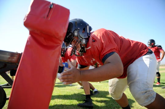 Offensive lineman Steven Sanchez works on his technique during a Rio Mesa High practice. The retooled Spartans open the season Friday at Camarillo High.