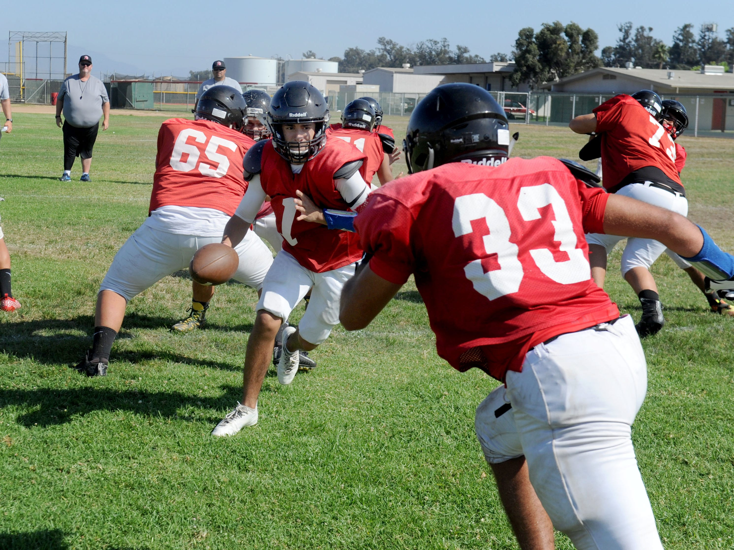 Quarterback Anthony Johnston gets ready to hand the ball to Moses Marsico during Rio Mesa High's practice on Wednesday. The Spartans start the 2018 season at Camarillo High on Friday night.