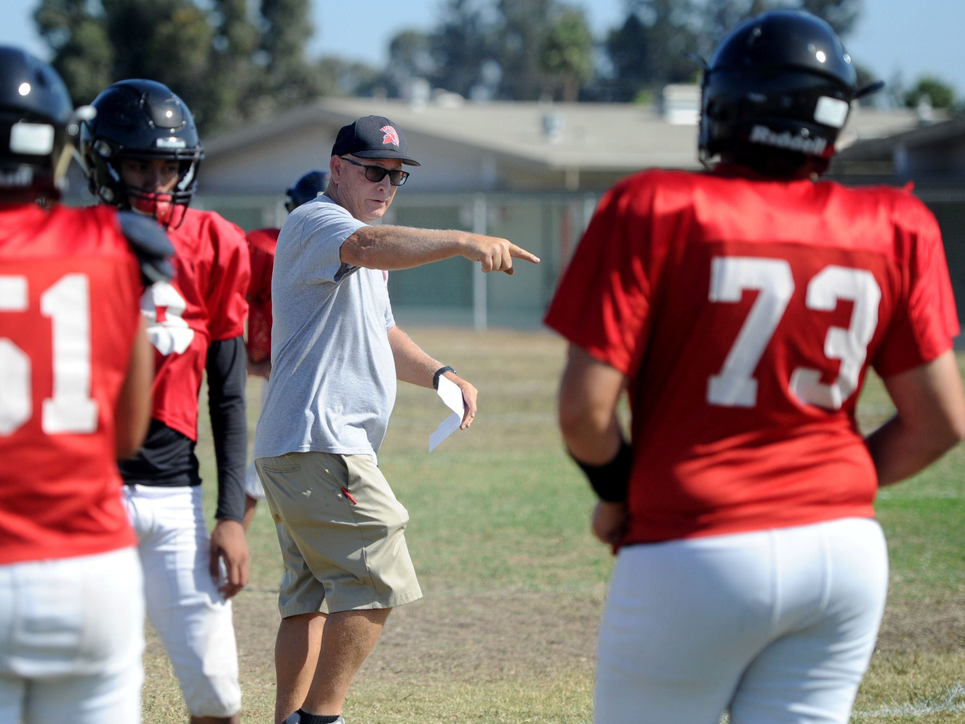 Rio Mesa High head coach Jim Bittner gives some pointers during Wednesday's practice. The Spartans open the 2018 season at rival Camarillo High on Friday night.