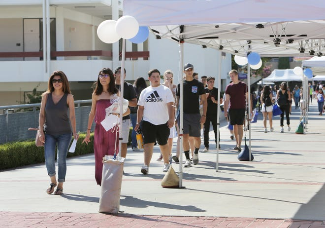 New students and their parents tour the Moorpark College campus during a welcome event on Wednesday.