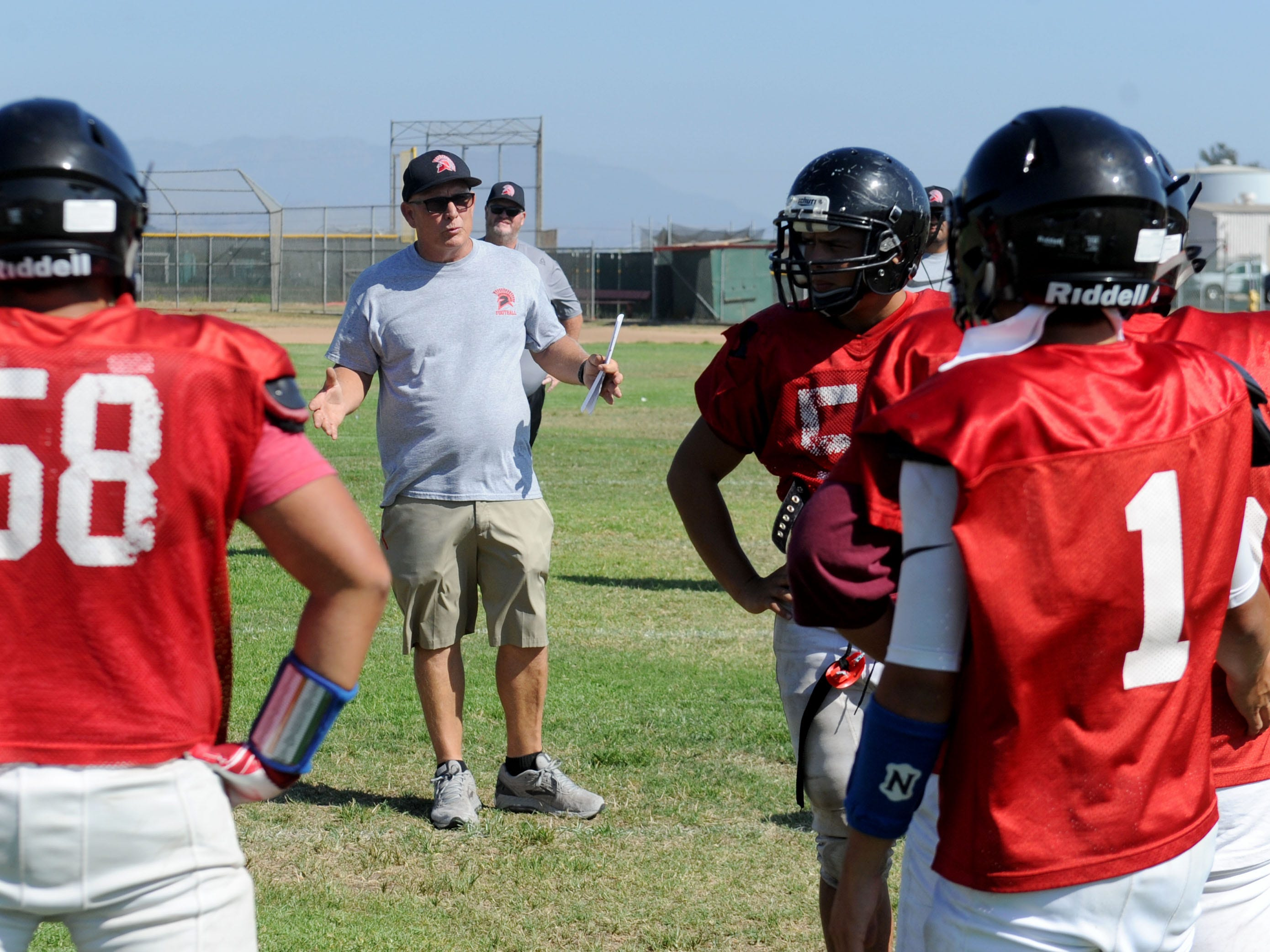 Rio Mesa head coach Jim Bittner gives instructions to his players at practice Wednesday. The Spartans start the 2018 season at Camarillo High on Friday night.
