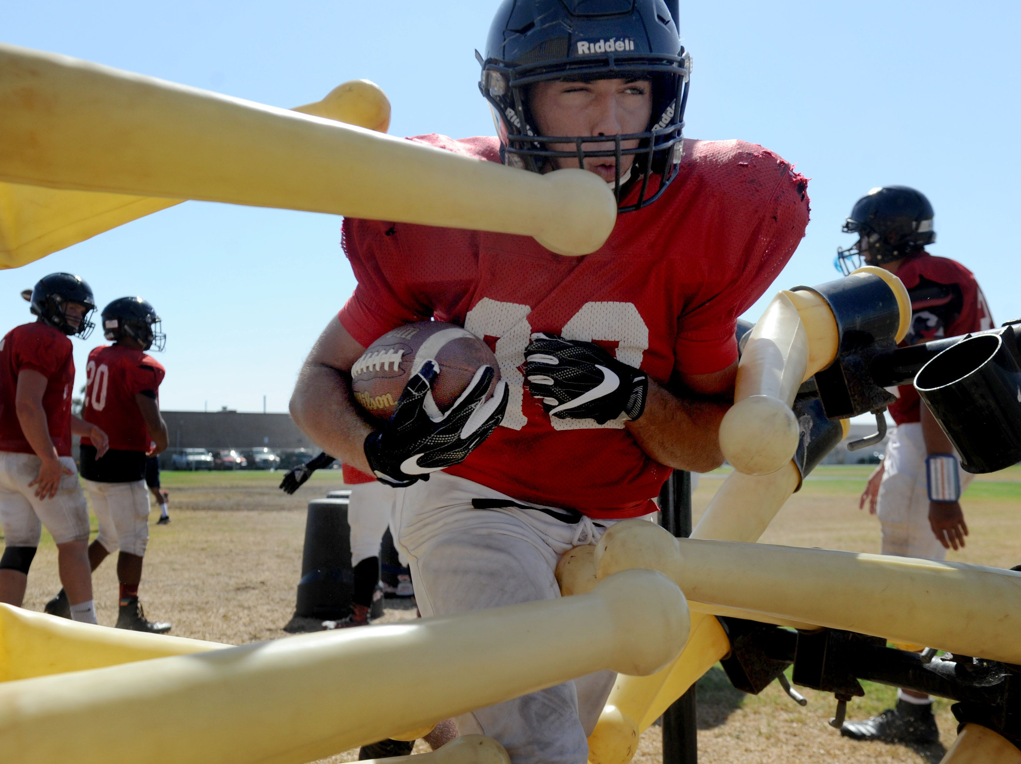 Running back Moses Marsico goes through some drills at Rio Mesa High practice. The Spartans open the season at Camarillo High on Friday night.