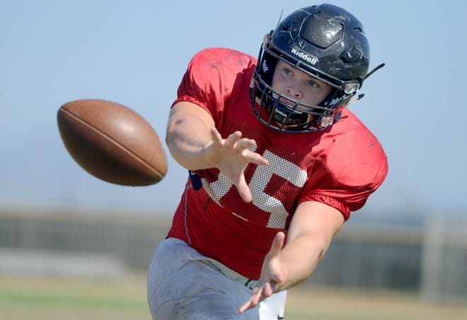 Rio Mesa High running back Blake Kytlica makes a catch during Wednesday's practice. The Spartans open the season at rival Camarillo on Friday night.