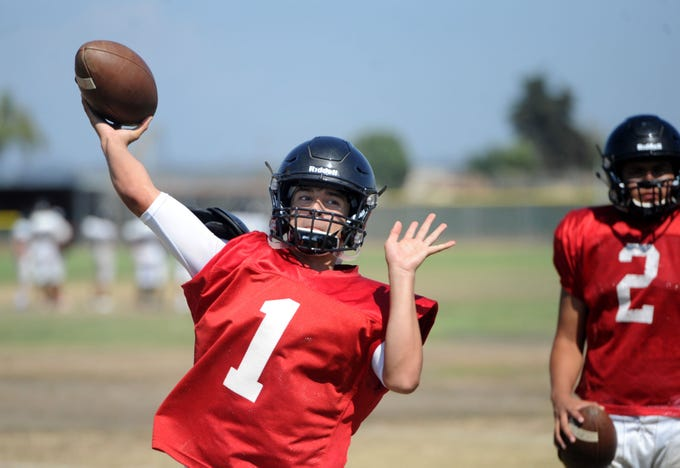 Anthony Johnston throws a pass during Rio Mesa High's practice. Johnston has some big shoes to fill at quarterback, taking over for Austin Maciel.