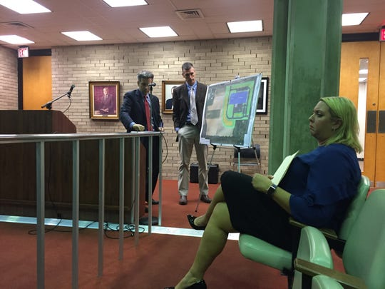 The Vineland Zoning Board dealt with a site plan application for a new South Jersey Glass & Door facility at a hearing Wednesday night. Attorney A. Steven Fabietti (standing, left) and engineer Matt Baldino testified on the application, which was approved. SJG&D Manager Jodi Trivellini (seated) also attended.