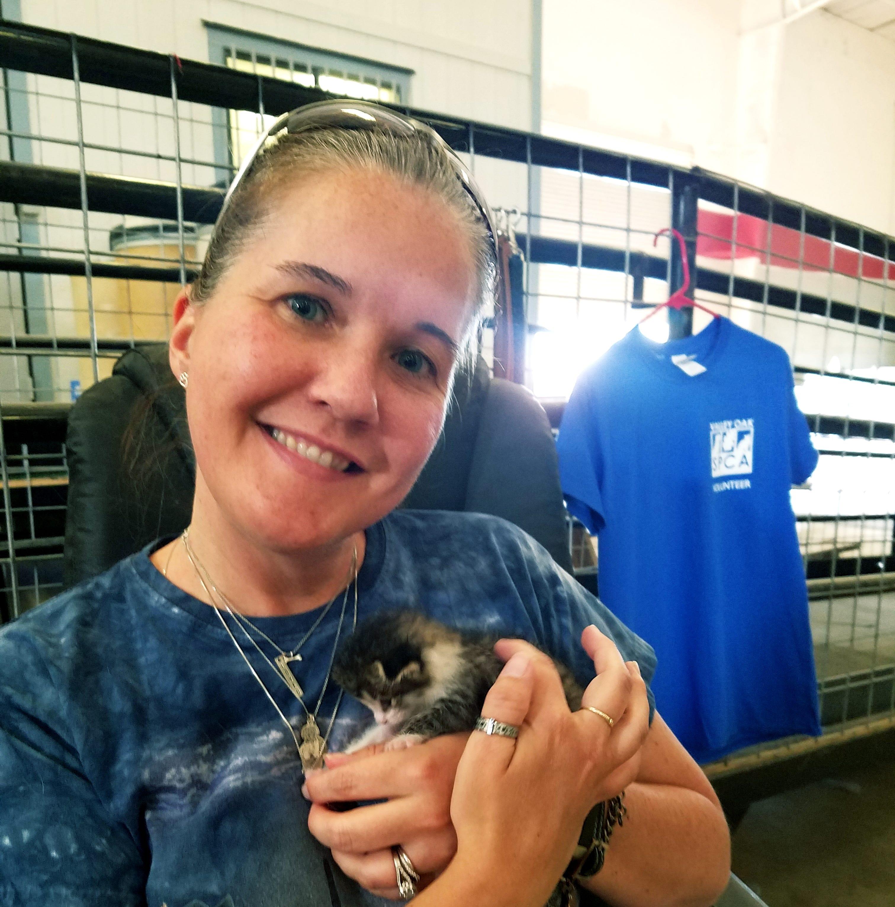 Denise Gruzensky holds a kitten during Valley Oak SPCA's Critter Camp over the summer.