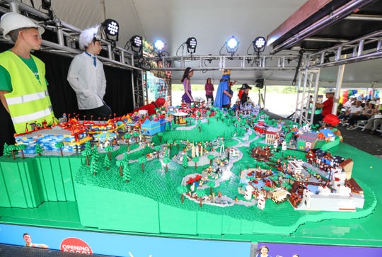 Local children help with a scale model of the park during a tour of the construction progress of LEGOLAND New York in Goshen on Thursday, August 16, 2018.