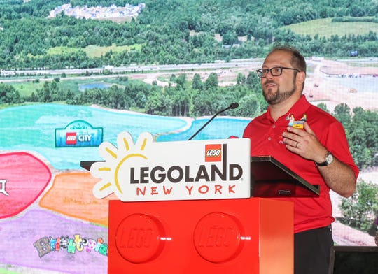 Public and media relations director Matt Besterman offers remarks during a tour of the construction progress of LEGOLAND New York in Goshen on Thursday, August 16, 2018.
