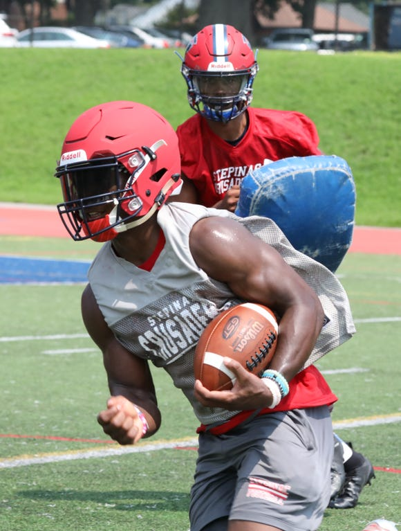 Stepinac senior Malik Grant runs the ball during the first day of preseason football practice in White Plains, Aug. 16, 2018.