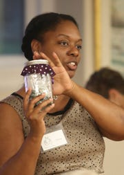 Ebony Maddrey leads a portion of the Wholehearted Living recovery program meeting at the Trinity Episcopal Church in Wilmington.