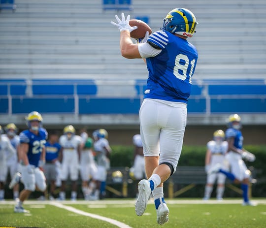 Blue Hens tight end Bryce De Maille makes the reception during practice Thursday morning at Delaware Stadium.