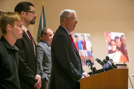 At a 2018 press conference announcing a federal lawsuit are (left to right): Brendan Leach, son of the late Capt. Christopher Leach; Attorney Stephen Neuberger; retired firefighter Brad Speakman; and Attorney Thomas Neuberger.