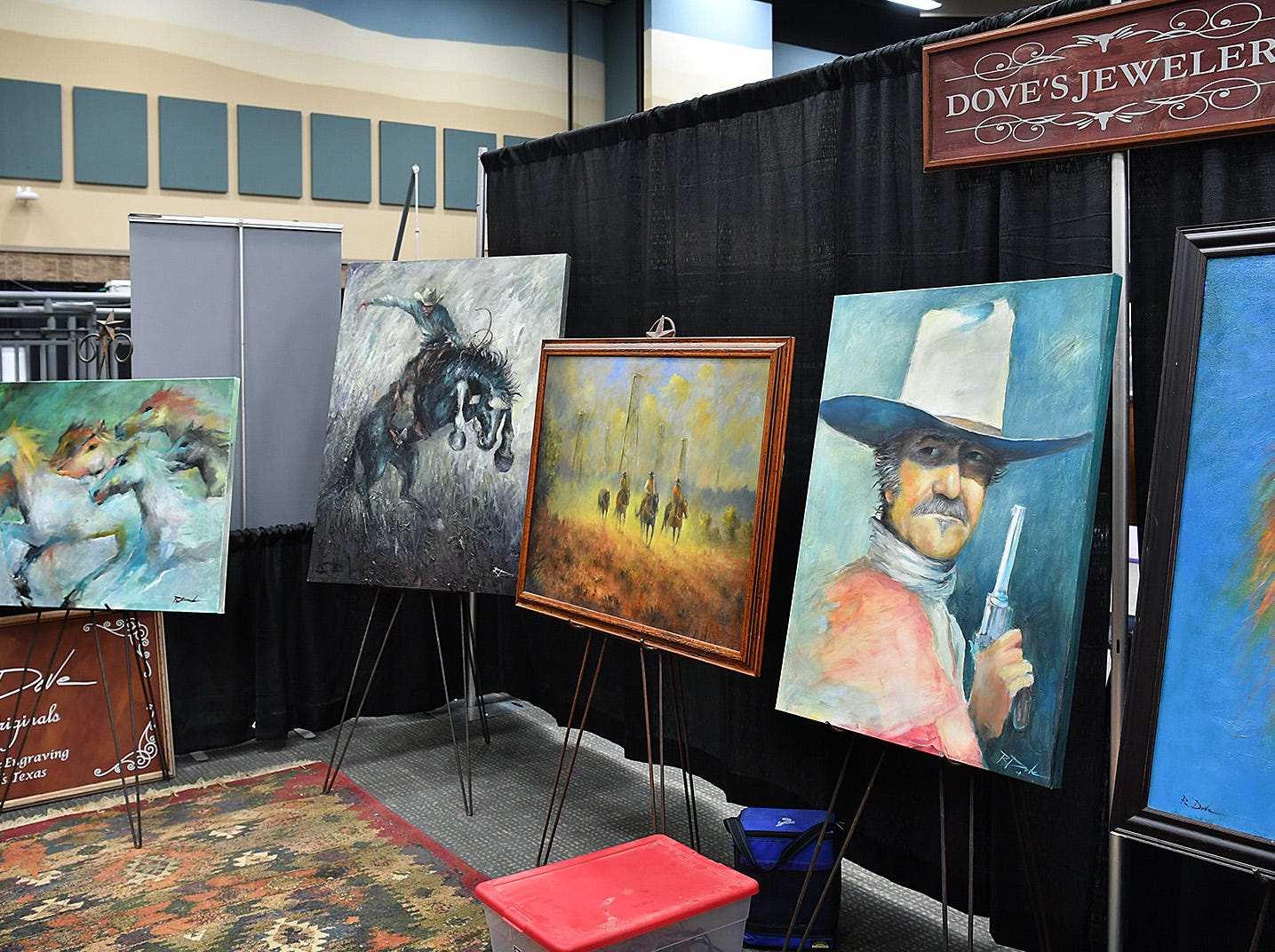 A display of Western artwork by Wichita Falls artist Bobby Dove on display at the Texas Ranch Roundup trade show Thursday morning at the Ray C;ymer Exhibit Hall.