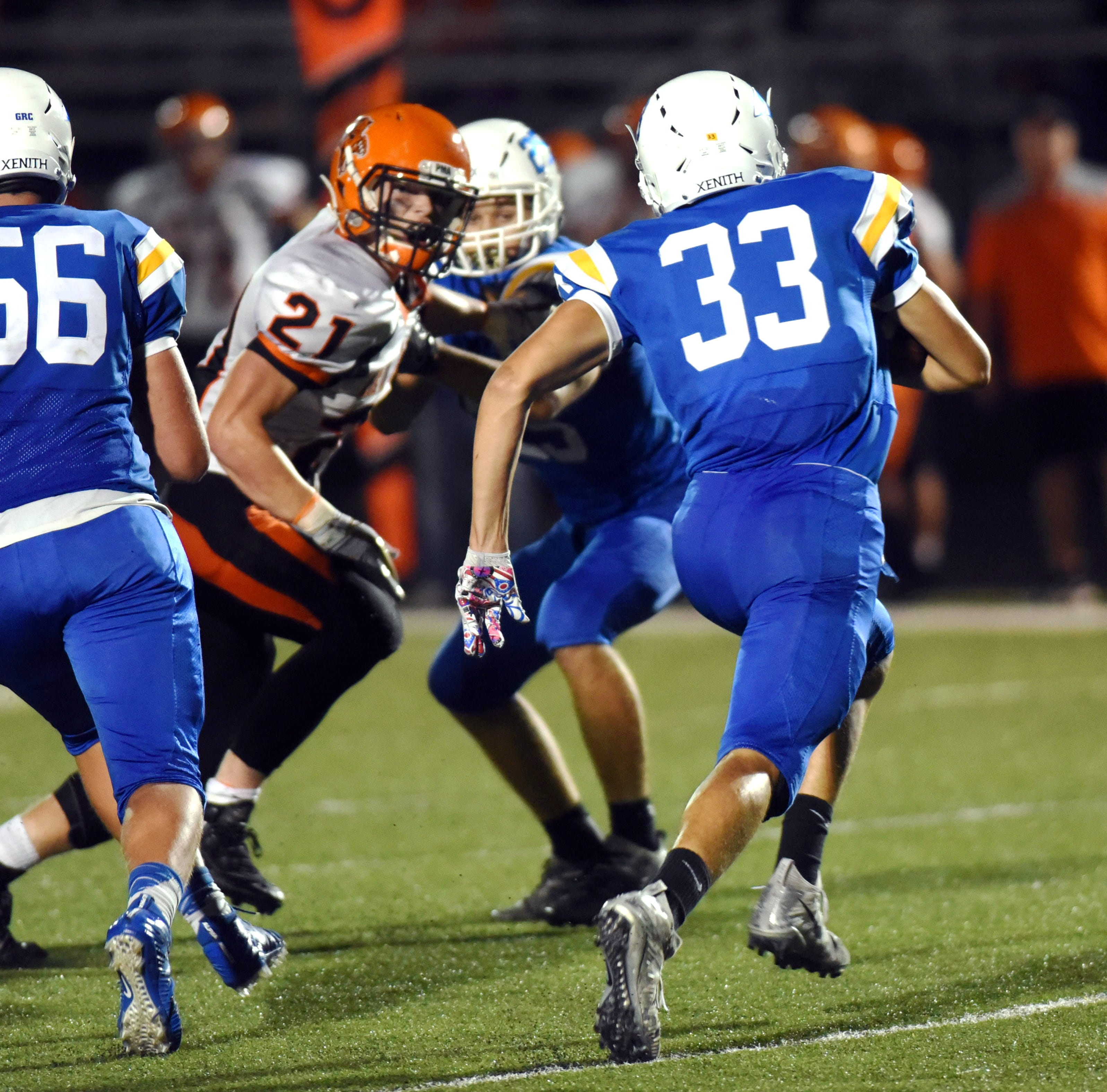 New Lexington's Christian Vance (21) tries to reach Maysville's Johnathon Brennen last season. Vance is among several starters returning for first-year coach Bill Franks.