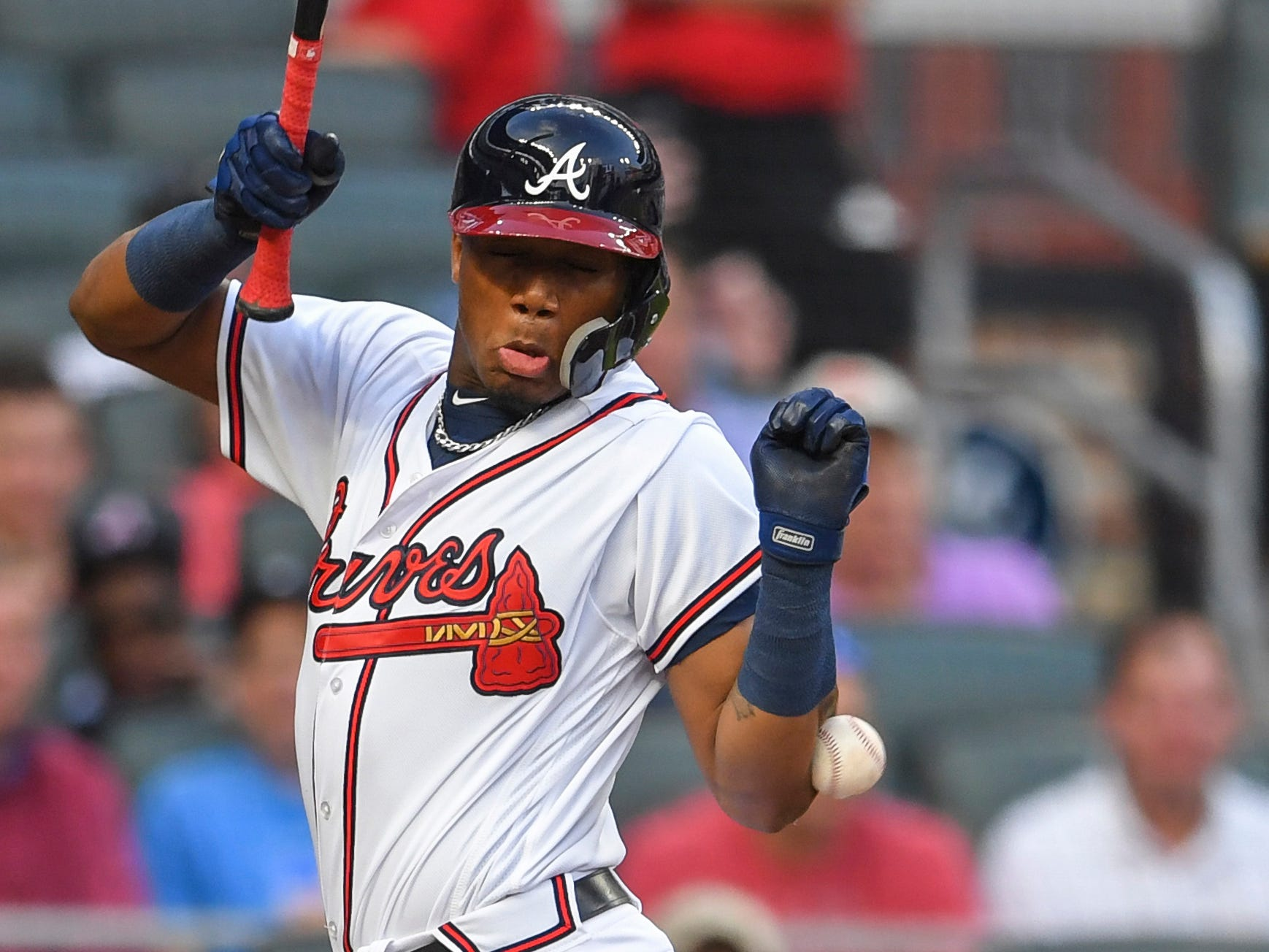 Ronald Acuna Jr. is hit by the first pitch of the game against the Marlins.