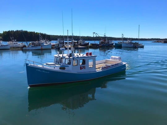 Boat captain Mackie Greene prepares to transport guests from Back Bay to Campobello Island. On the crossing, it's not uncommon to spot minke whales, porpoises and occasionally a rare North Atlantic right whale.