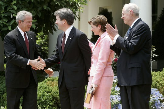 Brett Kavanaugh shakes hands with President George W. Bush after being sworn in by Supreme Court Justice Anthony Kennedy as a judge on the U.S. Court of Appeals for the District of Columbia Circuit on June 1, 2006.