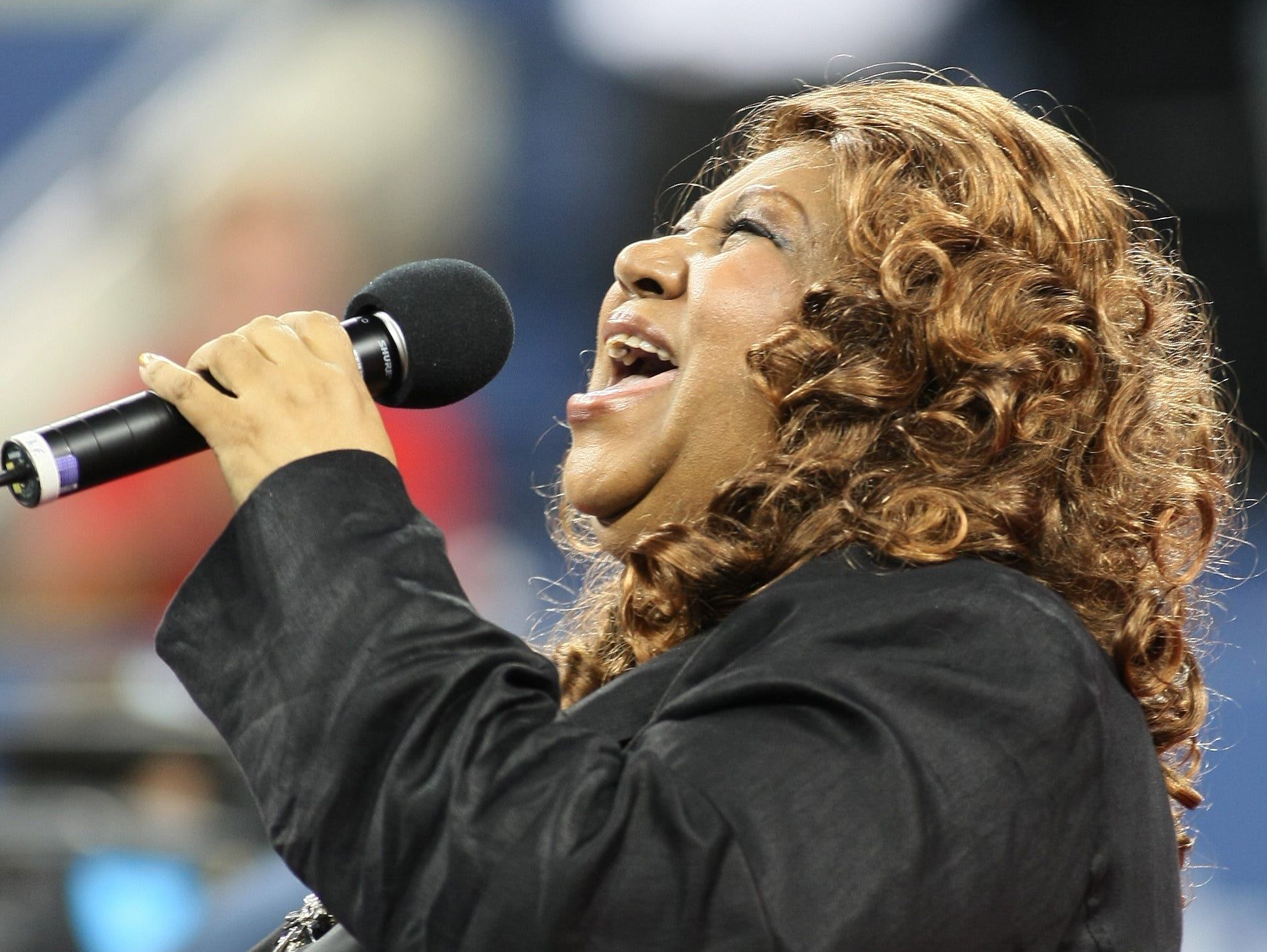 (FILES) In this file photo taken on August 27, 2007 Singer Aretha Franklin performs during a ceremony honoring the late African-American tennis player Althea Gibson at the US Open in Flushing Meadows, New York. - Aretha Franklin died at the age of 76 on August 16, 2018 at her home in Detroit according to her publicist. (Photo by Don EMMERT / AFP)DON EMMERT/AFP/Getty Images ORIG FILE ID: AFP_18C7RJ