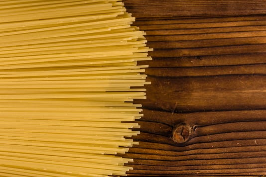 Bunch Of Spaghetti On Wooden Table Top View