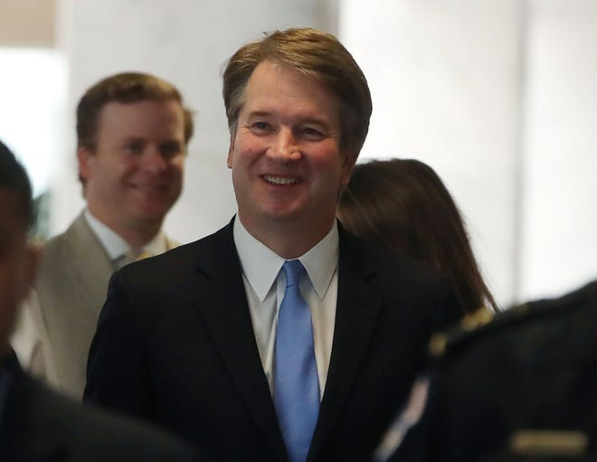 Supreme Court nominee Brett Kavanaugh walks to a meeting with Democratic Sen. Joe Donnelly on August 15 as he seeks confirmation to the seat of retired justice Anthony Kennedy.
