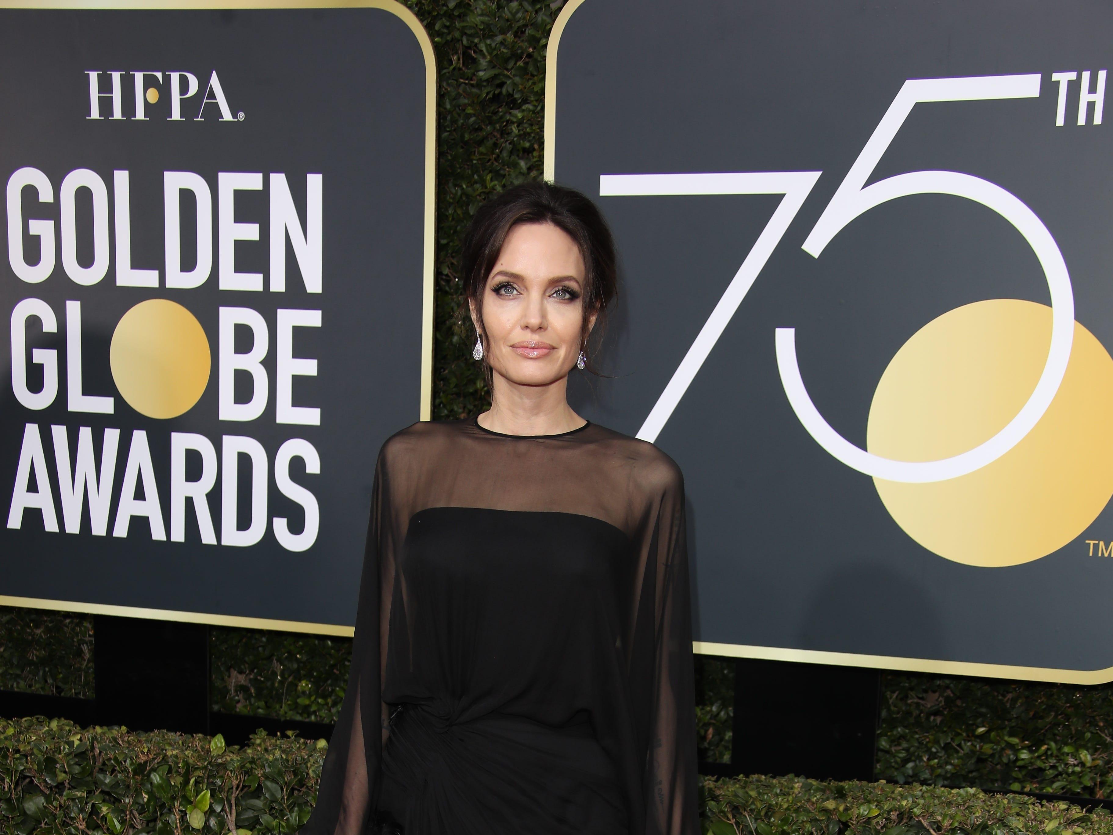 Jan 7, 2018; Beverly Hills, CA, USA;  Angelina Jolie arrives for the 75th Golden Globe Awards at the Beverly Hilton. Mandatory Credit: Dan MacMedan-USA TODAY NETWORK (Via OlyDrop)