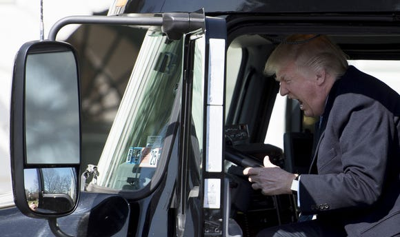 US President Donald Trump sits in the drivers seat of a semi-truck as he welcomes truckers and CEOs to the White House in Washington, DC, March 23, 2017, to discuss healthcare. / AFP PHOTO / JIM WATSON / ALTERNATIVE CROP JIM WATSON/AFP/Getty Images ORG XMIT: US Presid ORIG FILE ID: AFP_MX9AZ