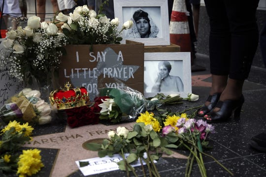 U.S. singer Aretha Franklin's star on the Hollywood Walk of Fame is adorned with flowers, candles and cards in Hollywood, California, on August 16, 2018.