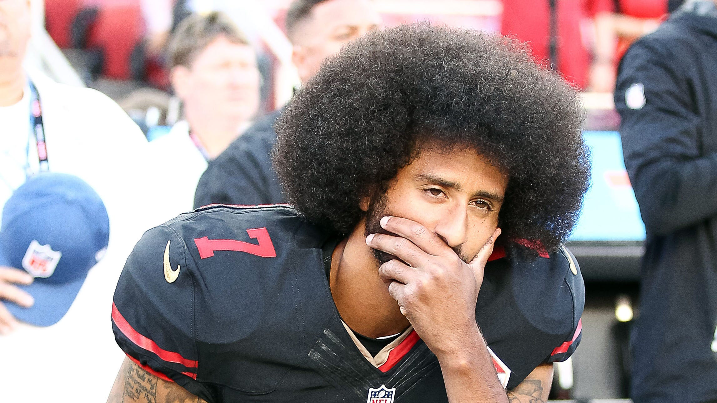 Colin Kaepernick kneels before a 2016 game against the Cardinals.