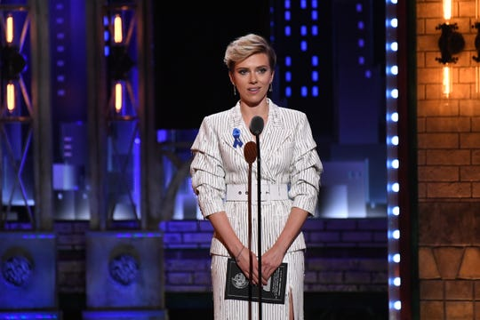 Scarlett Johansson headed off a paparazzi chase by driving to a police station Monday night.