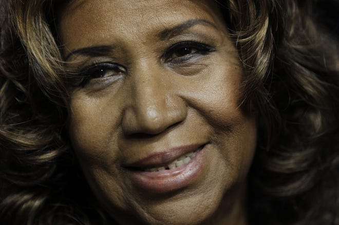 Aretha Franklin smiles after the Detroit Pistons-Miami Heat NBA basketball game in Auburn Hills, Michigan, on Feb. 11, 2011. Franklin died on Aug. 16, 2018, at her home in Detroit.  She was 76.