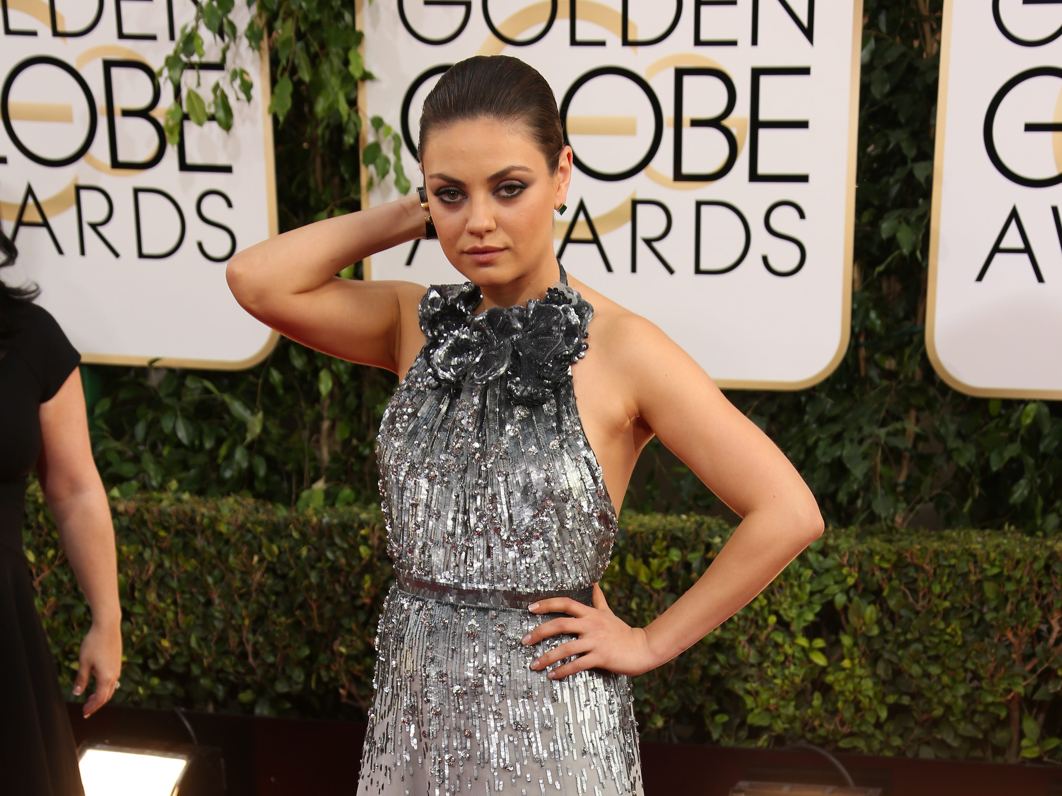 1/12/14 5:20:00 PM -- Beverly Hills, CA, U.S.A  --  Mila Kunis arrives at the 71st annual Golden Globe Awards in Beverly Hills, CA --    Photo by Dan MacMedan, USA TODAY contract photographer  ORG XMIT:  DM 130549 2014 GOLDEN GLOB 1/11/2014 (Via OlyDrop)